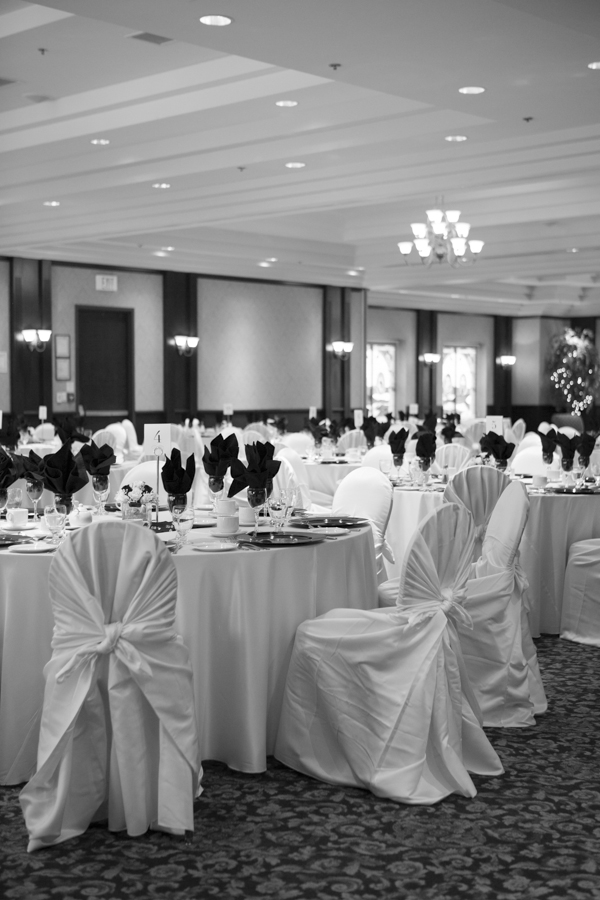 niagara-wedding-photographer-eva-derrick-photography-casablanca-winery-niagara-weddings-bride-groom-black-and-white-winter-wedding-photographers-wedding-reception-centerpiece-winter-theme-snowflakes-glass-chairs-chair-covers-photo.jpg