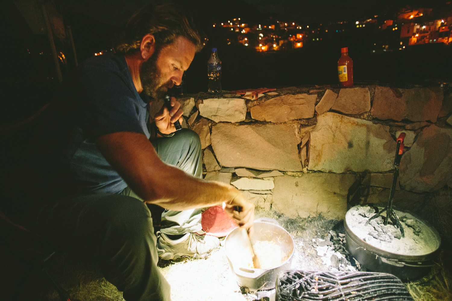 Chris cooking ribs in a dutch oven.