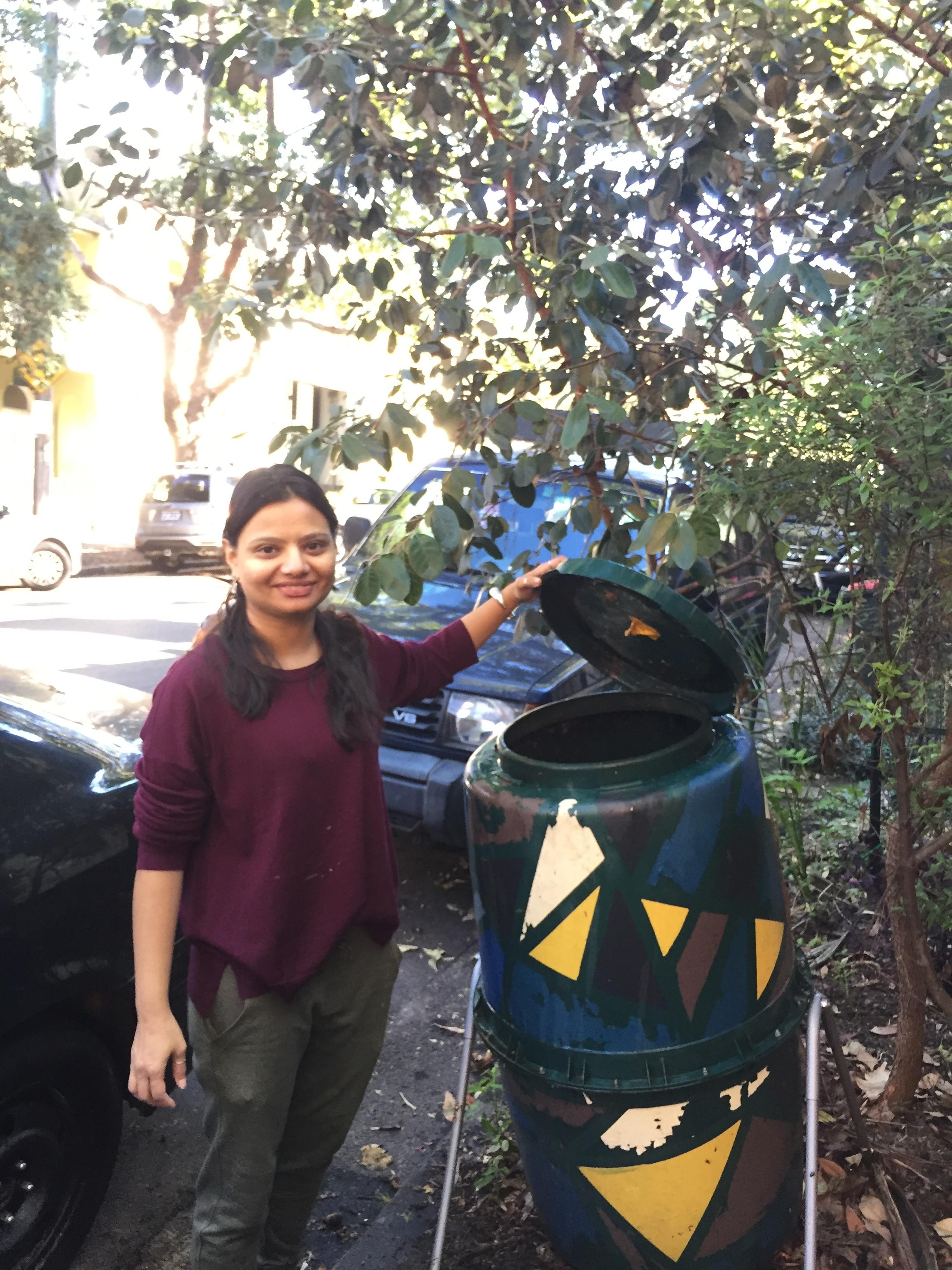 Tanaya taking care of a compost bin