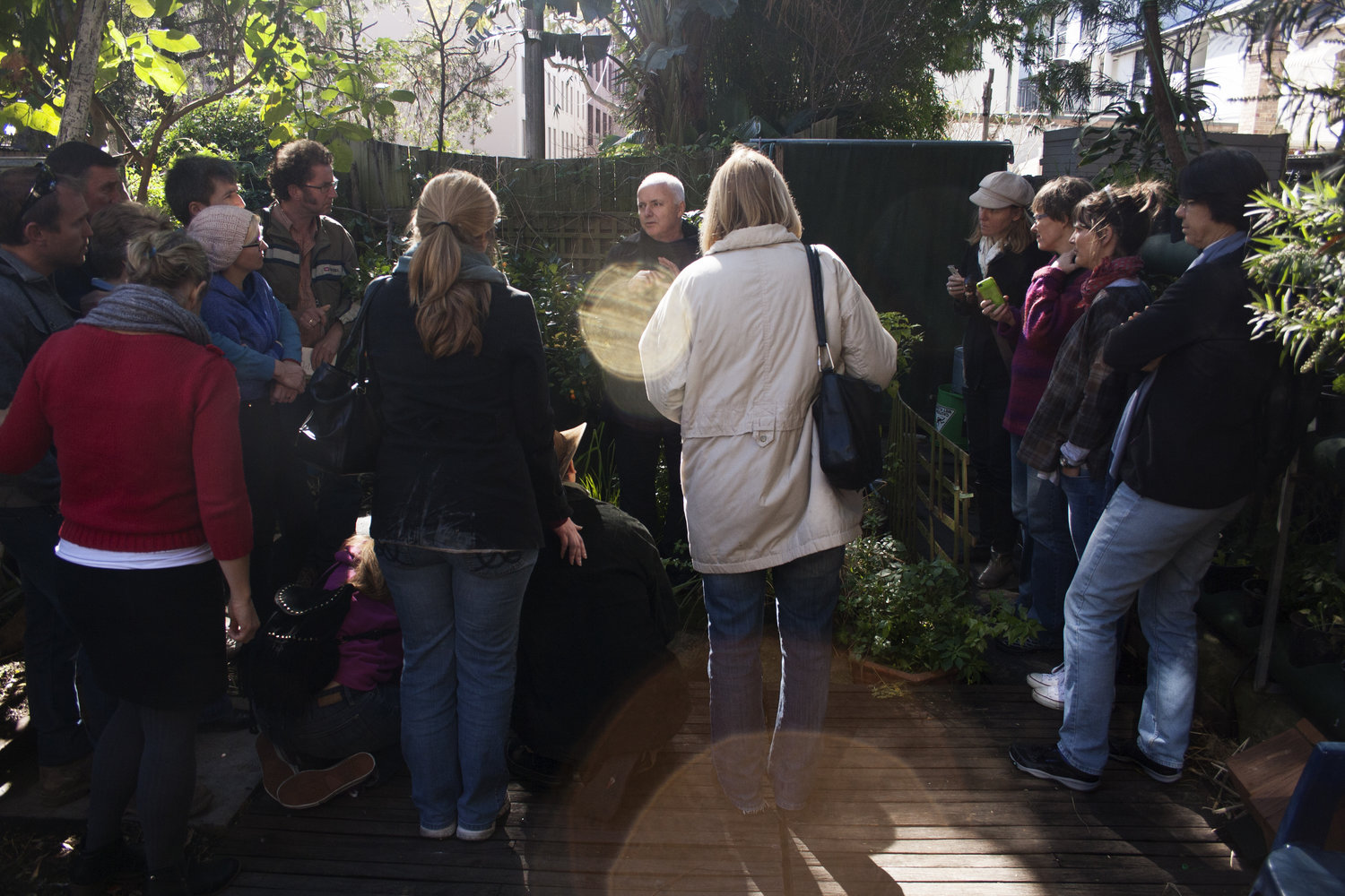 A tour group in the garden of Sydney's Sustainable House