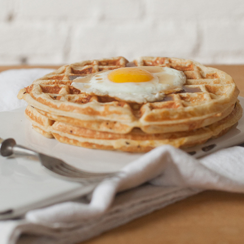 maple onion cheddar waffles with fried eggs