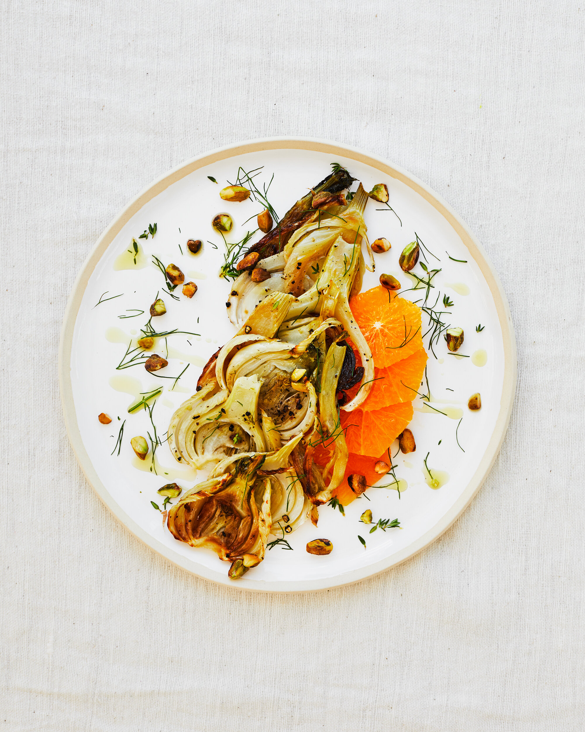 Roasted Fennel, Pistachio & Orange Salad - gluten-free | serves 4 | Ingredients ⤵︎4 bulbs fennel2 oranges½ cup pistachios, shelled & chopped2 tbs olive oil + additional for servingSalt and pepper
