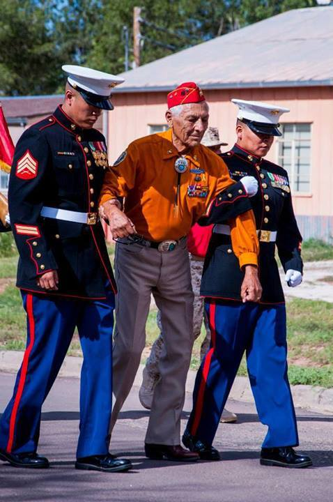 makarov92 :     Roy Hawthorne, Navajo Code Talker. USMC.     He walked the 2 mile parade route. Two Navajo Marines are helping him with the last ½ mile.