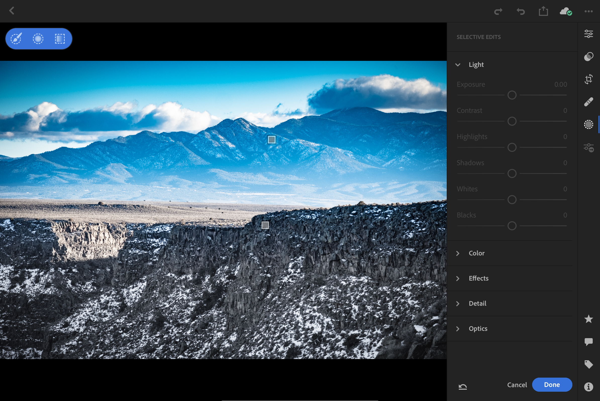 Lightroom CC offering a full suite of exposure and color edits as well as brushes, radial, gradient filters.