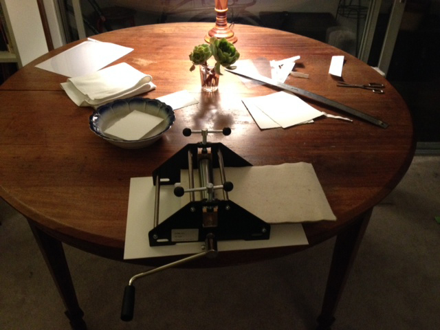 Printing on my family's old kitchen table. My Mom's summer cucumber salad bowl acting as paper soaking tray.