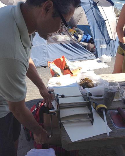Paul pulling a sand print.