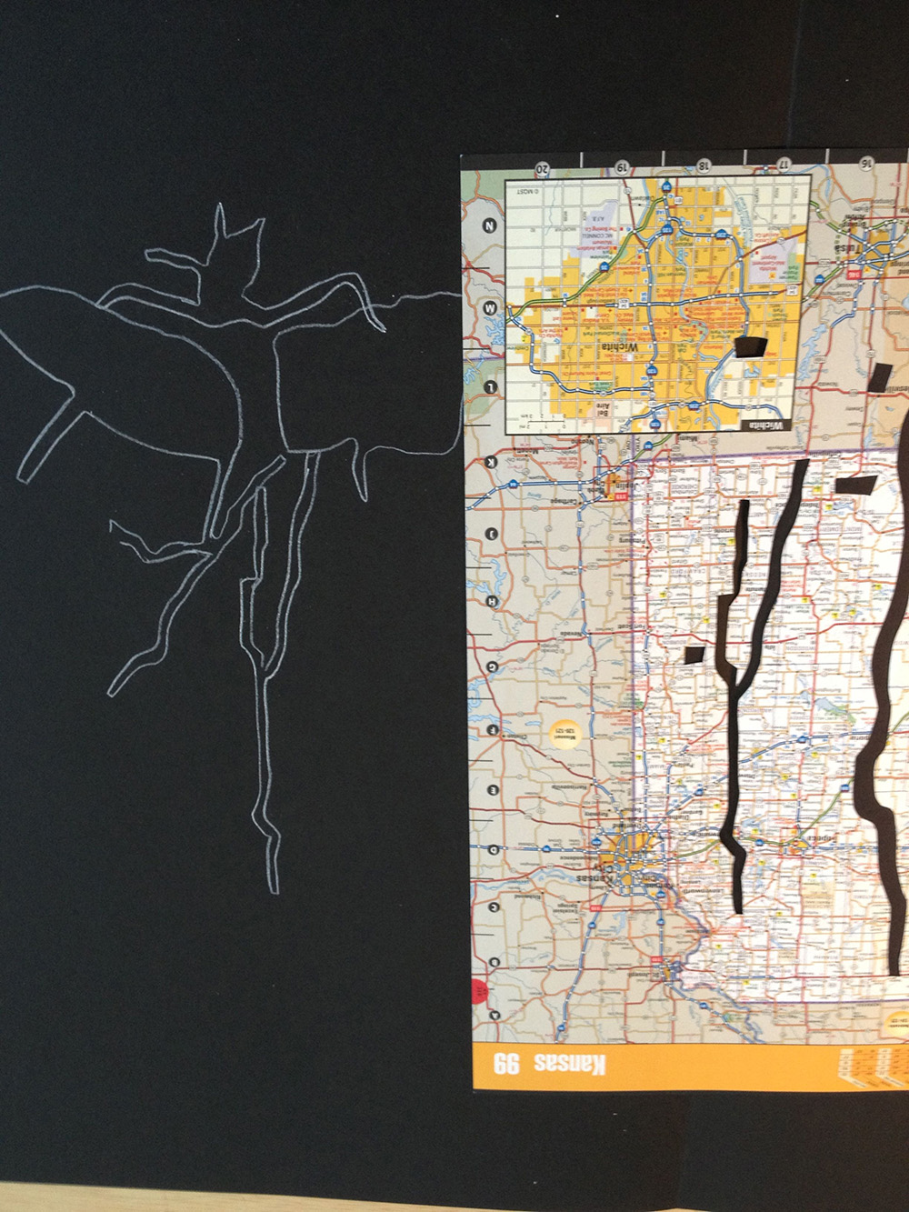 Working on the first Travel Hex drawing by tracing the removed road cut outs from the atlas.