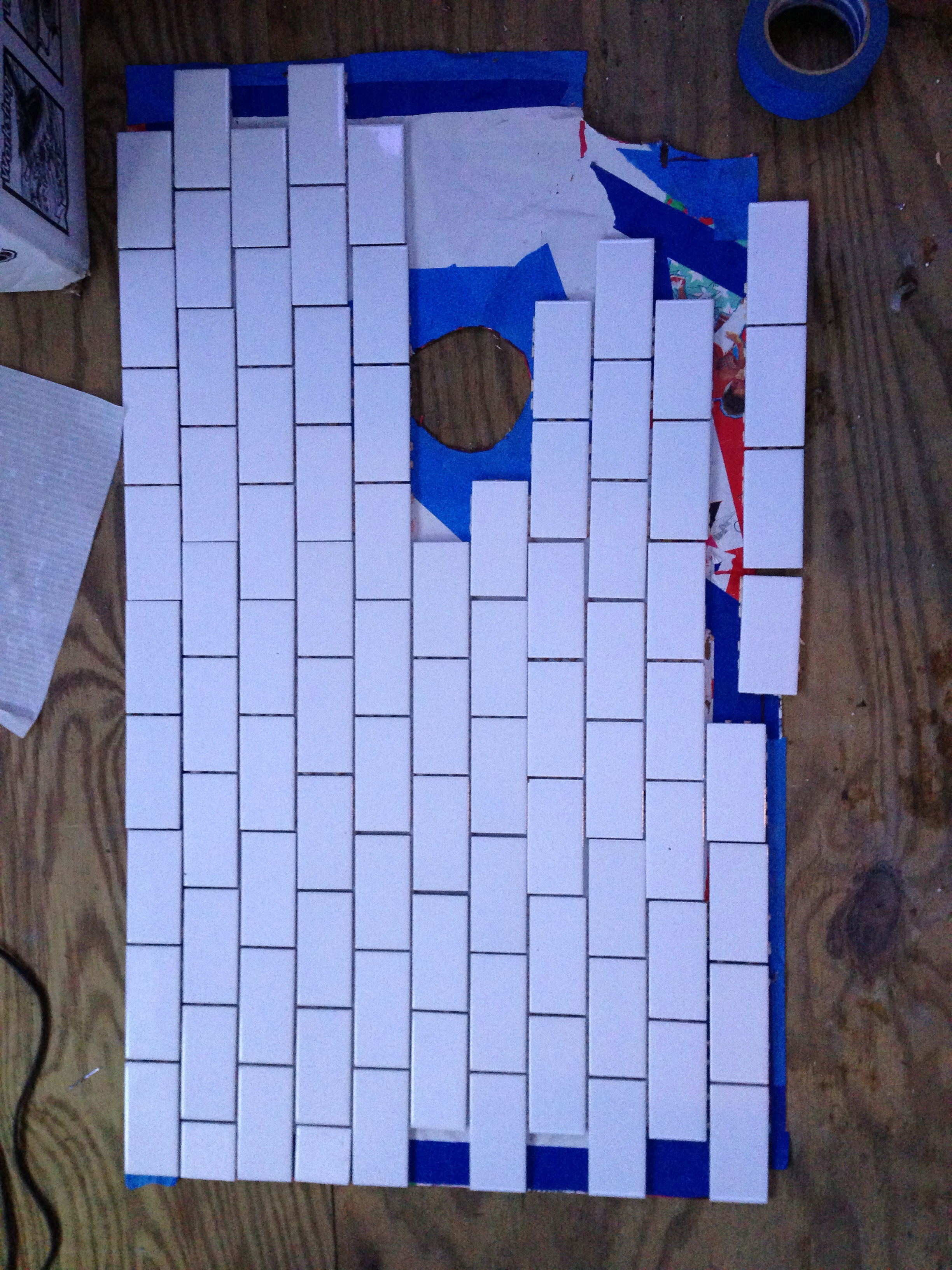 Laying out the tile pattern.