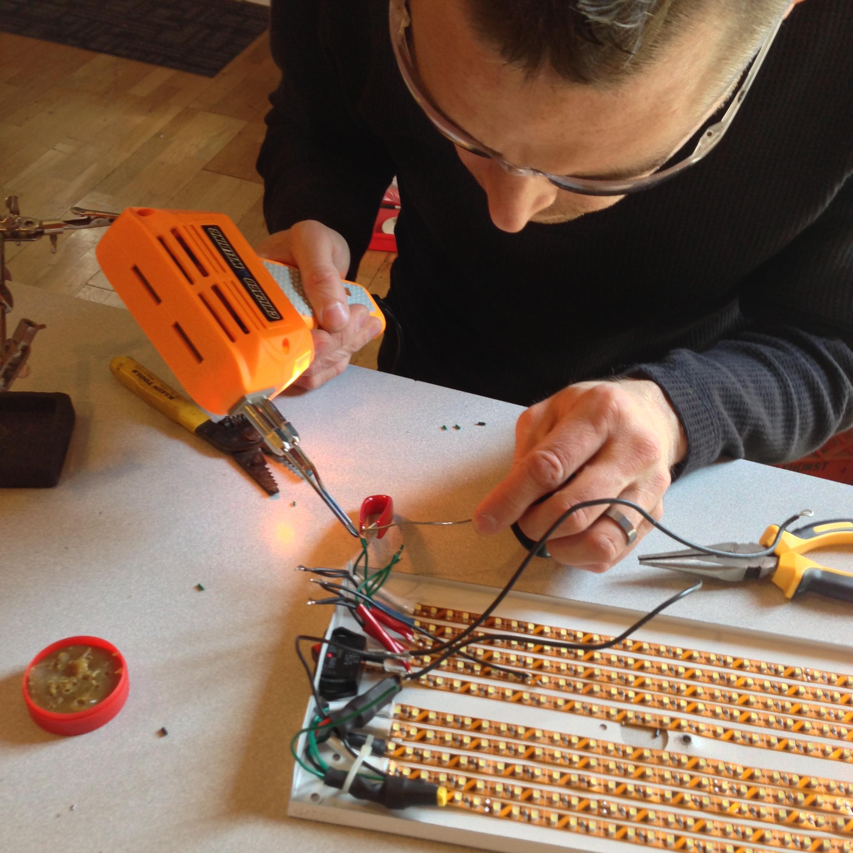 Michael soldering the first light fixture