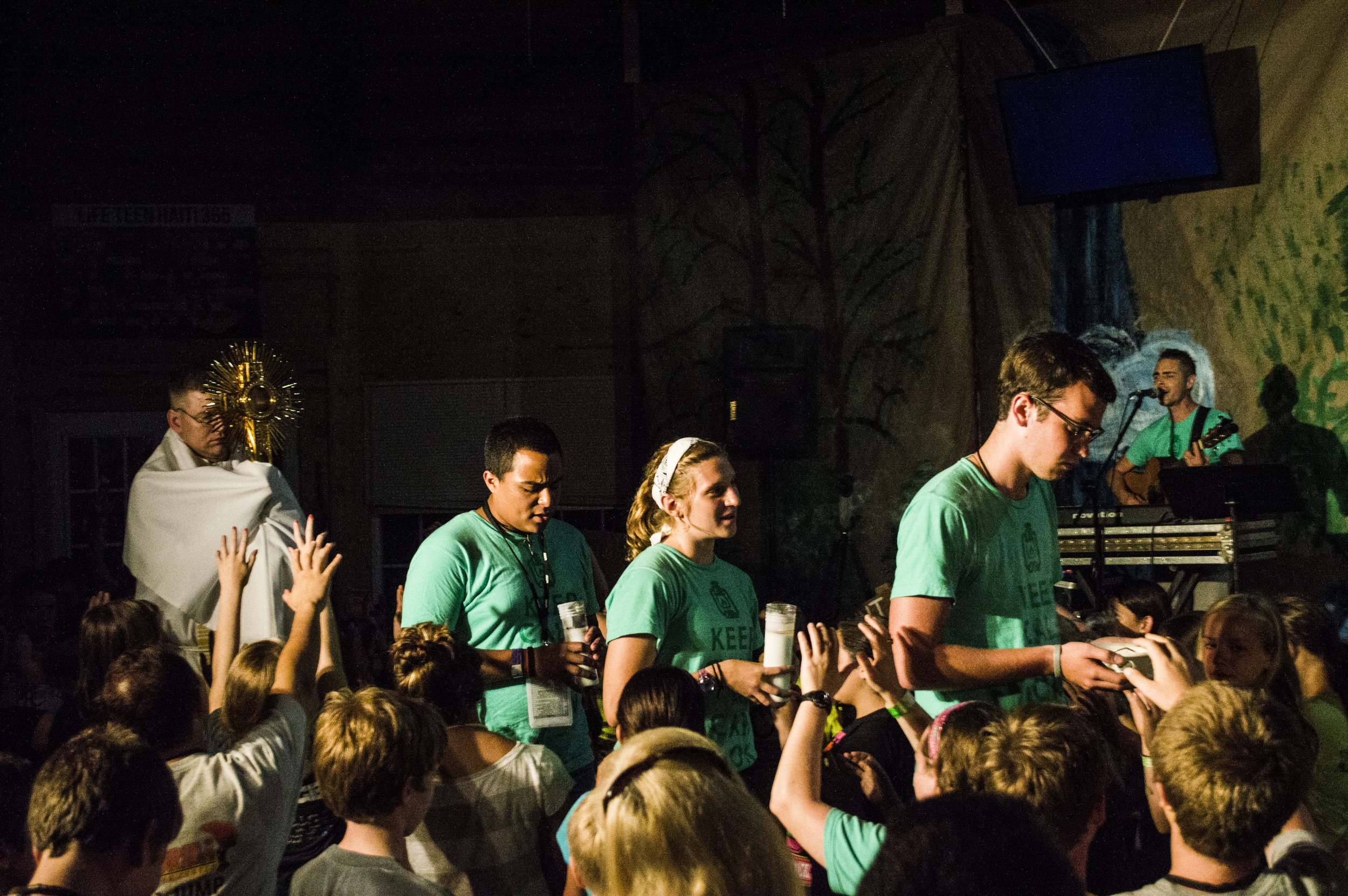 Adoration at Camp.  Photo by Dylan Himmerich