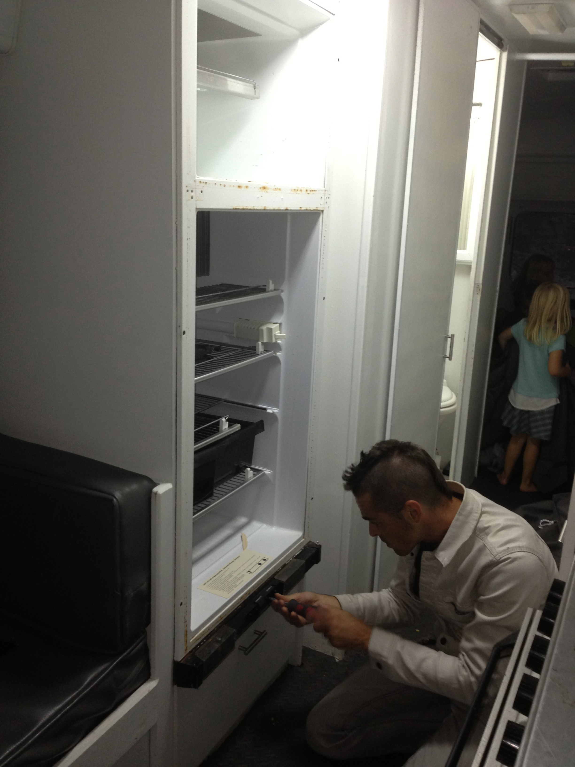 This is what being a rockstar looks like... replacing the refrigerator.