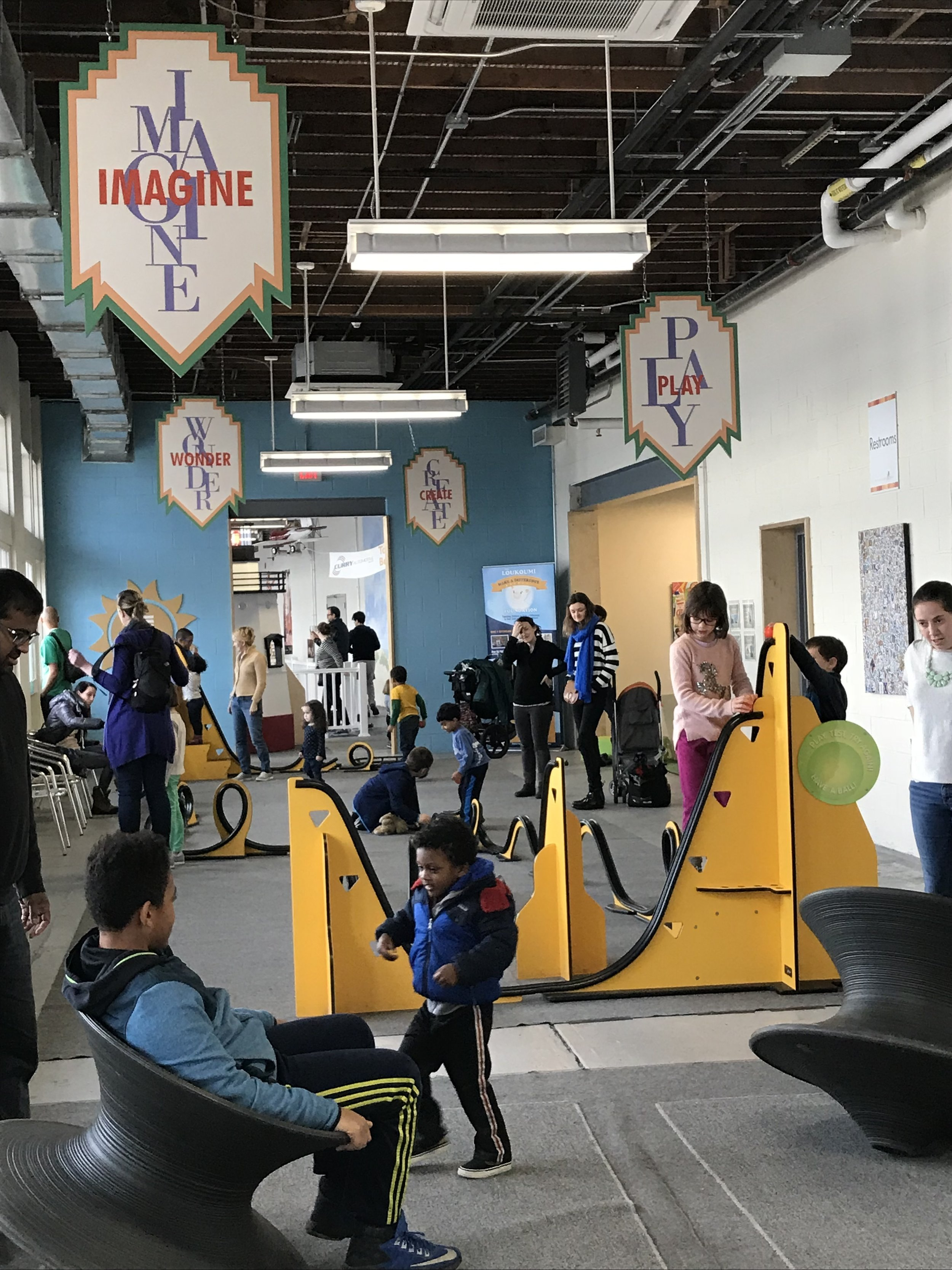Families enjoying their time together at the Westchester Children's Museum