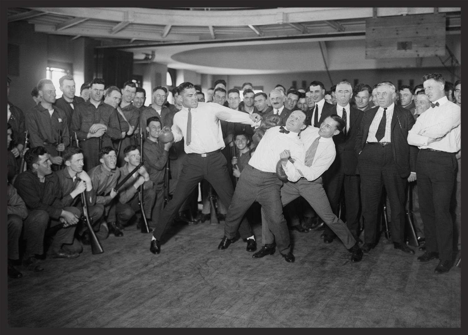 Heavyweight Champion Jack Dempsey prepares to throw a mock punch at Harry Houdini.