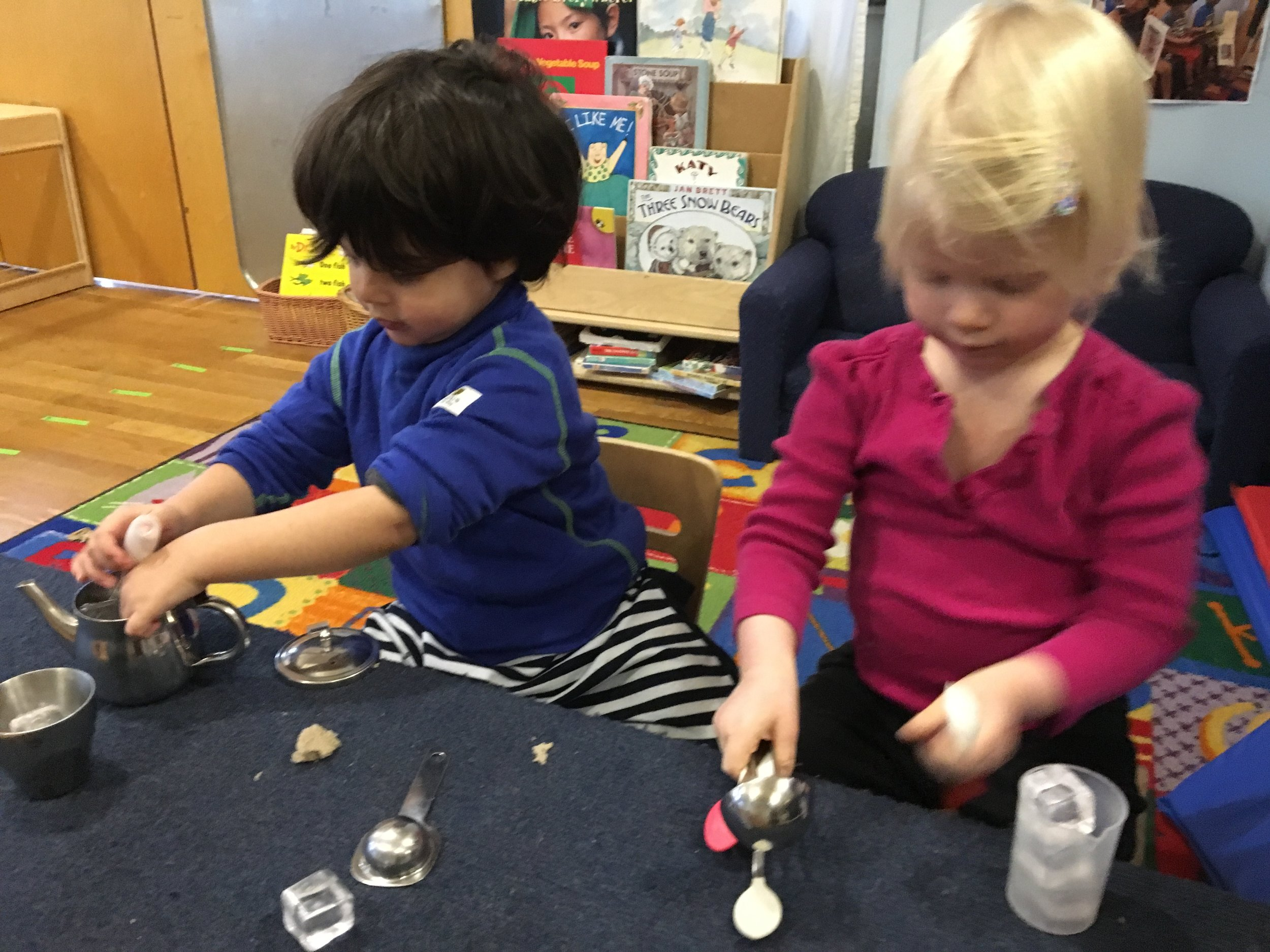 Soraya and Tiago are using materials from dramatic play-they are building social skills-learning how to play together in their pretend play