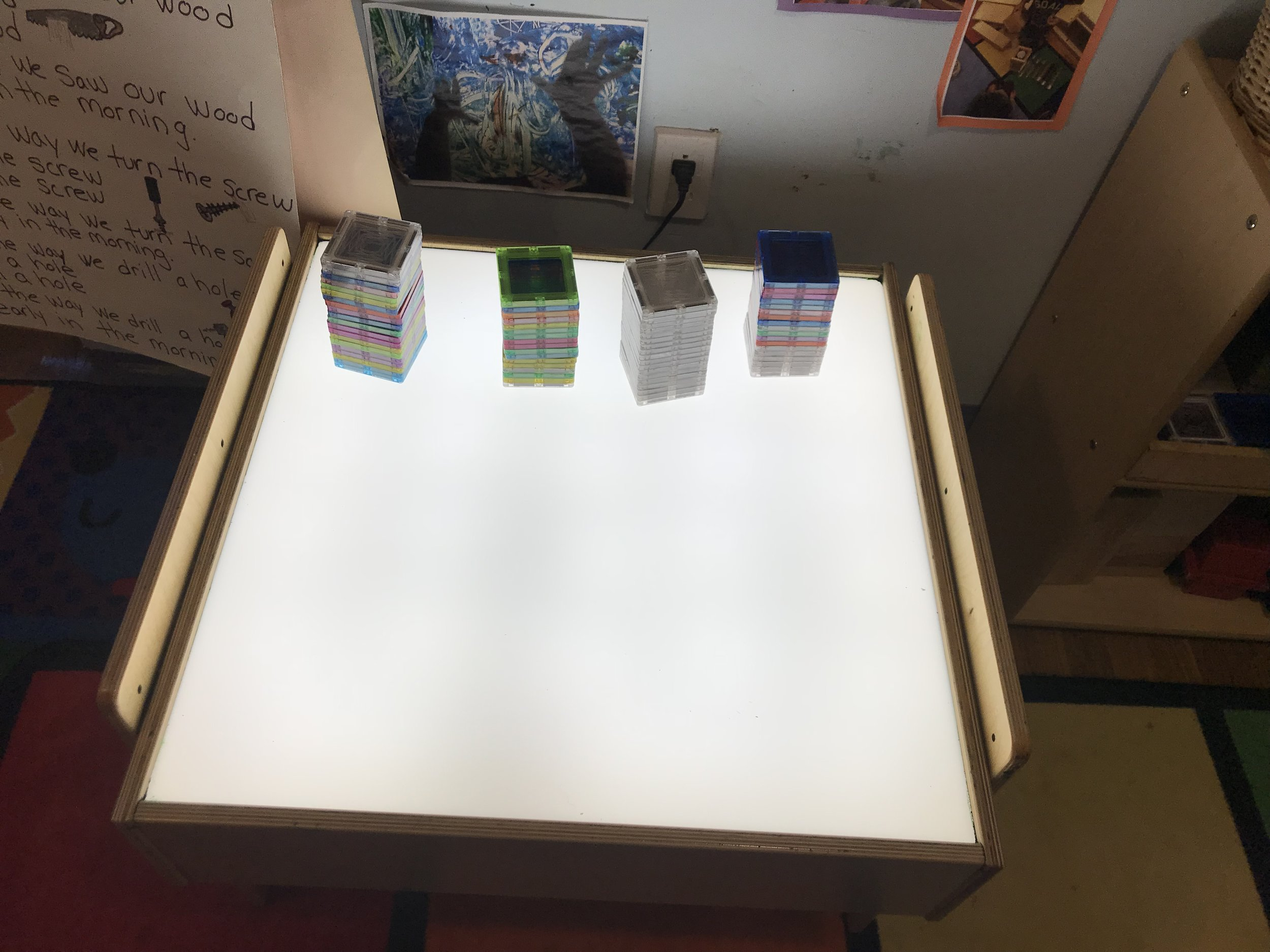 - Invitation to build at the light table with magnet tiles