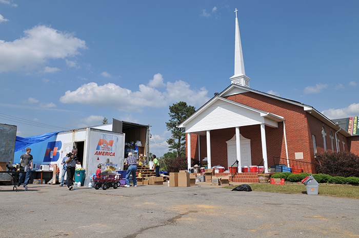 The Hackleburg Methodist Church (Alabama) serves as a disaster relief center for tornado survivors. Volunteers from Kansas and Wisconsin have come to help run the center. According to the Federal Emergency Management Agency (FEMA) faith-based organizations and groups are an integral part of the recovery process after disasters. (Photo Credit: By Tim Burkitt, courtesy FEMA, May 11, 2011).