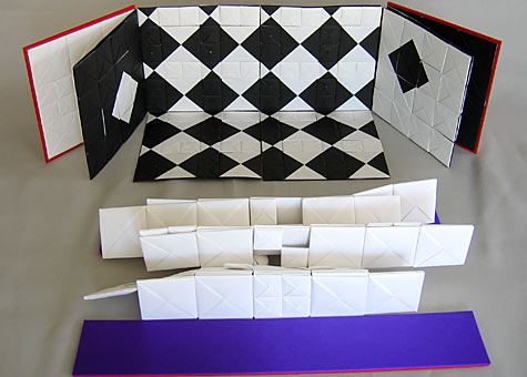 """Binder/Artist: Hisako Nakazawa: Series """"Endless"""" #H and #I. """"Endless"""" #H and #I are based on a Japanese trik book. The book can be endlessly expanded by connecting folded paper of various sizes. The box is an integrated part of the books. The structure is based on Japanese ORI-HON (folding book). Materials used: black and white paper and silk cloth."""