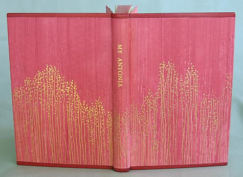 Binder: Joanne Page: Willa Cather, My Antonia, Vintage Books, Random House, Inc., NY,1994; Case binding sewn on tapes. Paste paper covers and fly leaves by the binder. Red goatskin edges on head and tail, Colored top edge with silk endbands; gold tooled cover decoration.