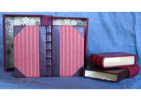 """Coleen Curry, """"Erasmus Collected Proverbs"""" Half goat skin leather binding with decorated Japanese paper. French binding with false raised bandes.on spine. Endpapers are the same Japanese paper as cover.. Inner special fireproof luxury box in same goat skin. Outer Japanese silk clamshell box. 17mm x 11mm"""