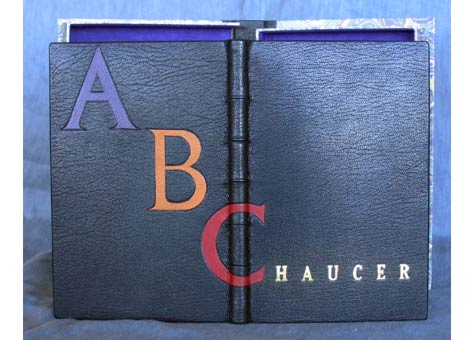 """Mark Davis Flaherty, """"Geoffery Chaucer's abc"""" by Geoffery Chaucer. Full black Oasis leather binding with raised bands, gold top, embroidered head bands, leather onlays and gilded title, decorative end-papers. Clamshell box of same leather with decorative paper and ultra-suede."""