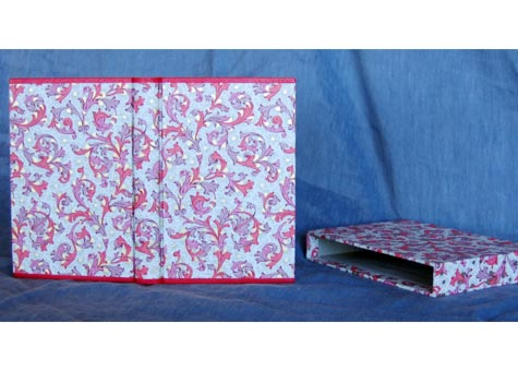 """C. L. Ingalls, """"Blank bookblock is made with hand torn Arches text 120 gsm."""" Book is covered with imported Italian decorated paper with Oasis leather at the head and tail. Matching decorated paper for headbands. Box of same decorated paper. 6 1/4 x 4"""