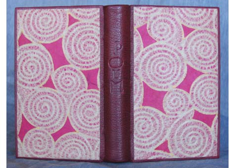 """Catherine Kornel, """"Poum"""" by Paul & Victor Margueritte. Half leather binding of Burgundy French Cape Morocco with collaged and stitched Japanese paper designed by binder. Embroidered silk headbands. End Papers are of Japanese handmade paper. 7 1/2 x 5 1/2"""