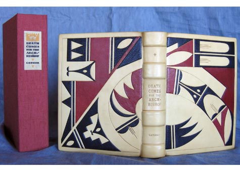 """Melinda Padgett, """"Death comes for the Archbishop"""" by Willa Cather. Ivory calf and Morocco onlays with blind tooling. Tight back binding with leather hinge and sewn on vellum. Endpapers are reproduction 1891 New Mexico maps. Asahi covered clamshell box. Silk double head bands. 8 x 6 1/2"""