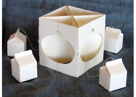 """Lyall F. Harris, """"Breastfeeding"""" by Lyall F. Harris, A white paper and string 4 x 4"""" carousel format plus 4 external elements."""