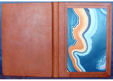 """Nysa Wong Kline, """"L'Infinito"""" A selection of translations of Leopardi's poem. Three-quarter binding in orange oasis. Onlays of turquoise calf. Blind-tooled titles in multiple languages frame the vibrant marbled paper to convey the essence of the poem. Sewn on cords with embroidered silk headbands in four colors. 9 1/2 x 13"""