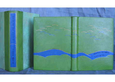 """Sabina U. Nies, """"Heaven on Earth"""" by John Muir. Harmatan goat binding with onlay of the same material. Water color and gold tooling for page edge treatment. Doublures and flyleaves are also of Harmantan goat skin. Deluxe clam shell box, rounded spine, handmade paste paper by Sun. 7 1/2 x 6 x 1"""