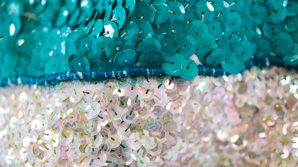 Since 1989 (detail) , 2017-2018,cotton, wool, sequins, felt , Port Adelaide member lanyards, cotton thread, Port Adelaide scarf, linen thread, half-made cotton t-shirt, synthetic curtains, metallic thread, donated dance costumes, Port Adelaide t-shirt, Port Adelaide membership pins, Official AFL Micro-Figures, Port Adelaide single bed quilt cover, wadding, merino knit fabric, rope, Port Adelaide socks, Port Adelaide earrings, curtain rings, tassels, beads, tarp, fake pearls, trimmings, Pat McGrath Labs sequins, lanyards, silk, t-shirt offcuts, sequinned fabric, Port Adelaide magnet, ribbon, Photography by Steph Fuller
