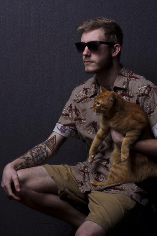 The only image from Facebook I could find that shows his tattoos..... and a cat.
