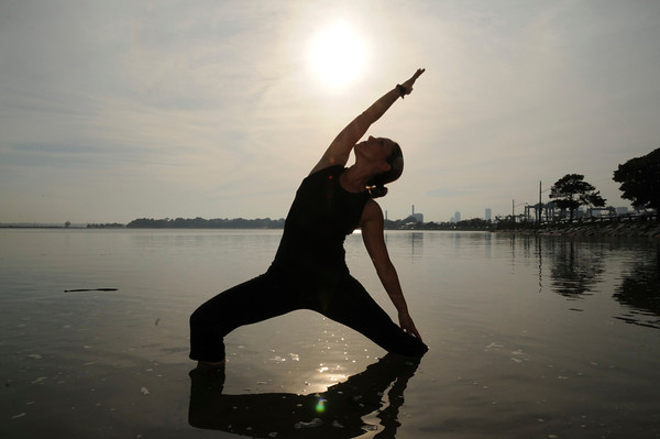 Rule #1, you may want to practice this pose on flat ground not in a body of water