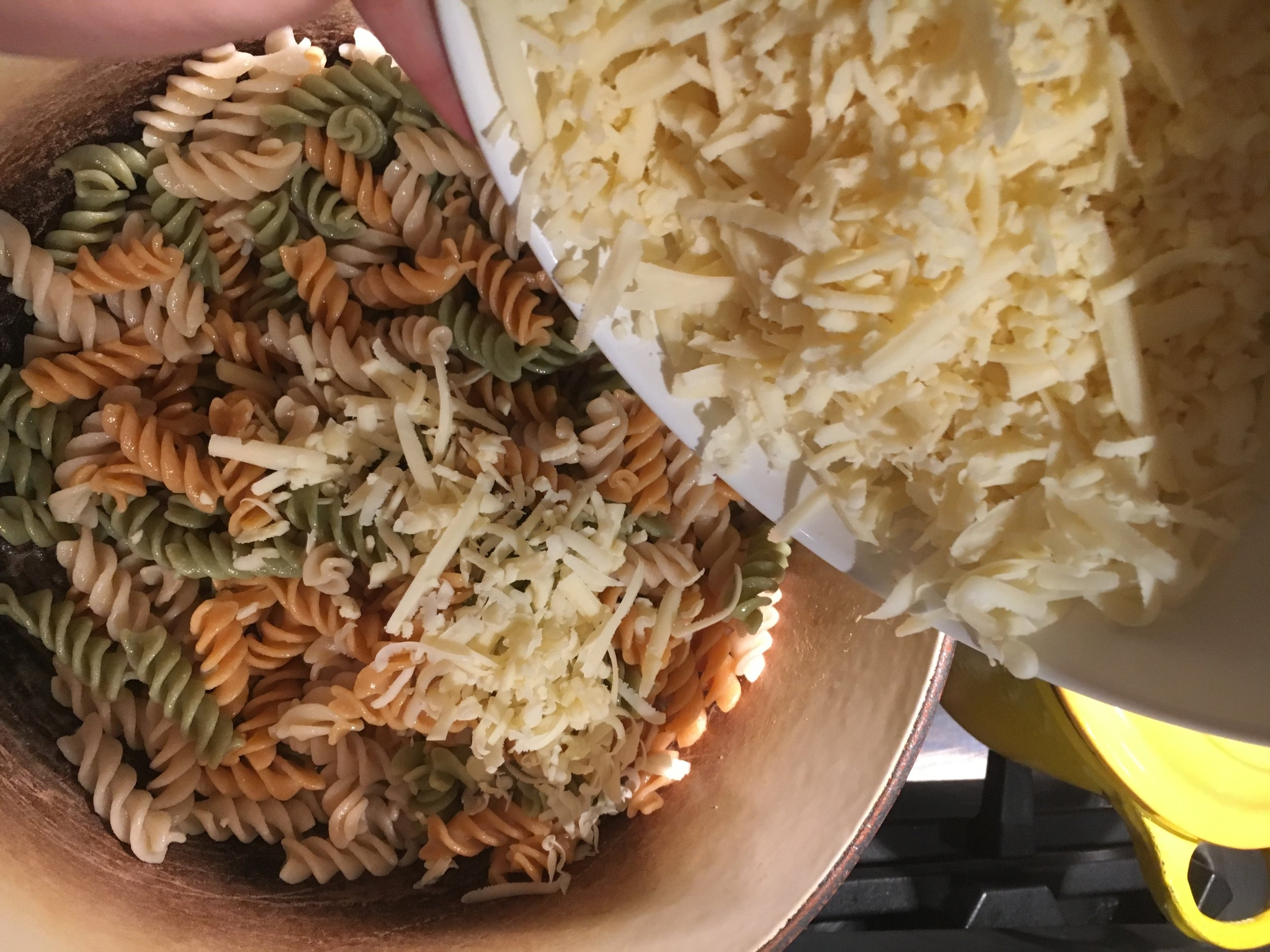 Be sure pasta is nice and hot so cheese melts evenly into the pasta.