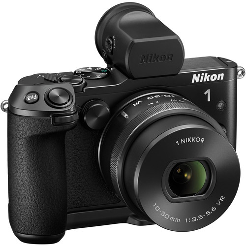 The Nikon 1 V3 with Viewfinder attached and beefy grip. Still a pretty compact package.