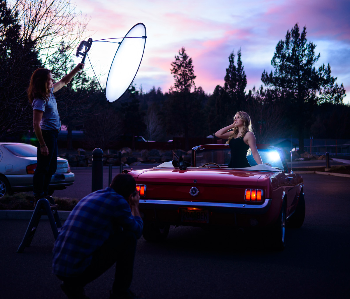a second speedlight was placed on the hood of the car for an edge light