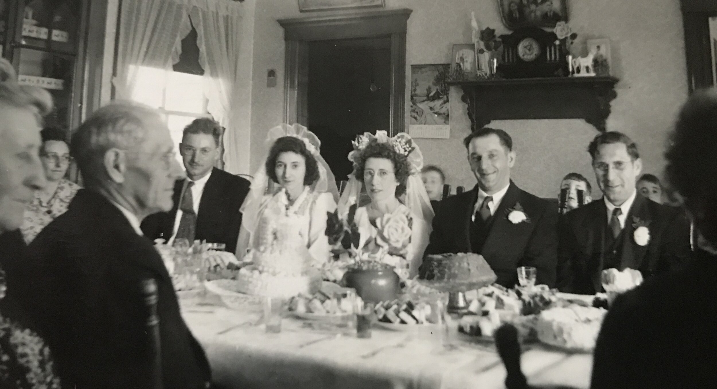 """One of the many unnamed and unknown individuals photographed and found amongst the """"old stuff."""" However, do note the copious amount of sweets, cakes, and whatnot, eaten at many traditional Acadian weddings at the turn of the century."""