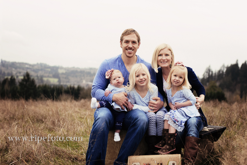 Portrait of family in field by Portland photographer Ripe Photography.