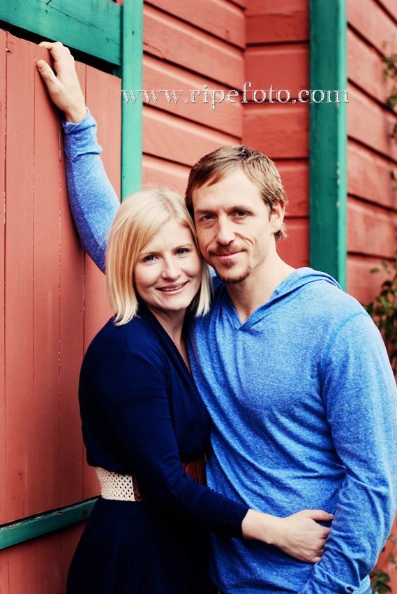 Portrait of couple next to red barn by Portland photographer Ripe Photography.