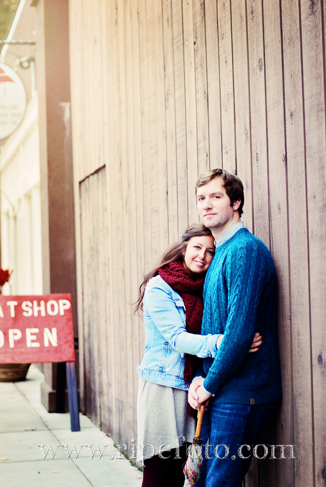 Portrait of couple on wooden wall background by Ripe Photography.