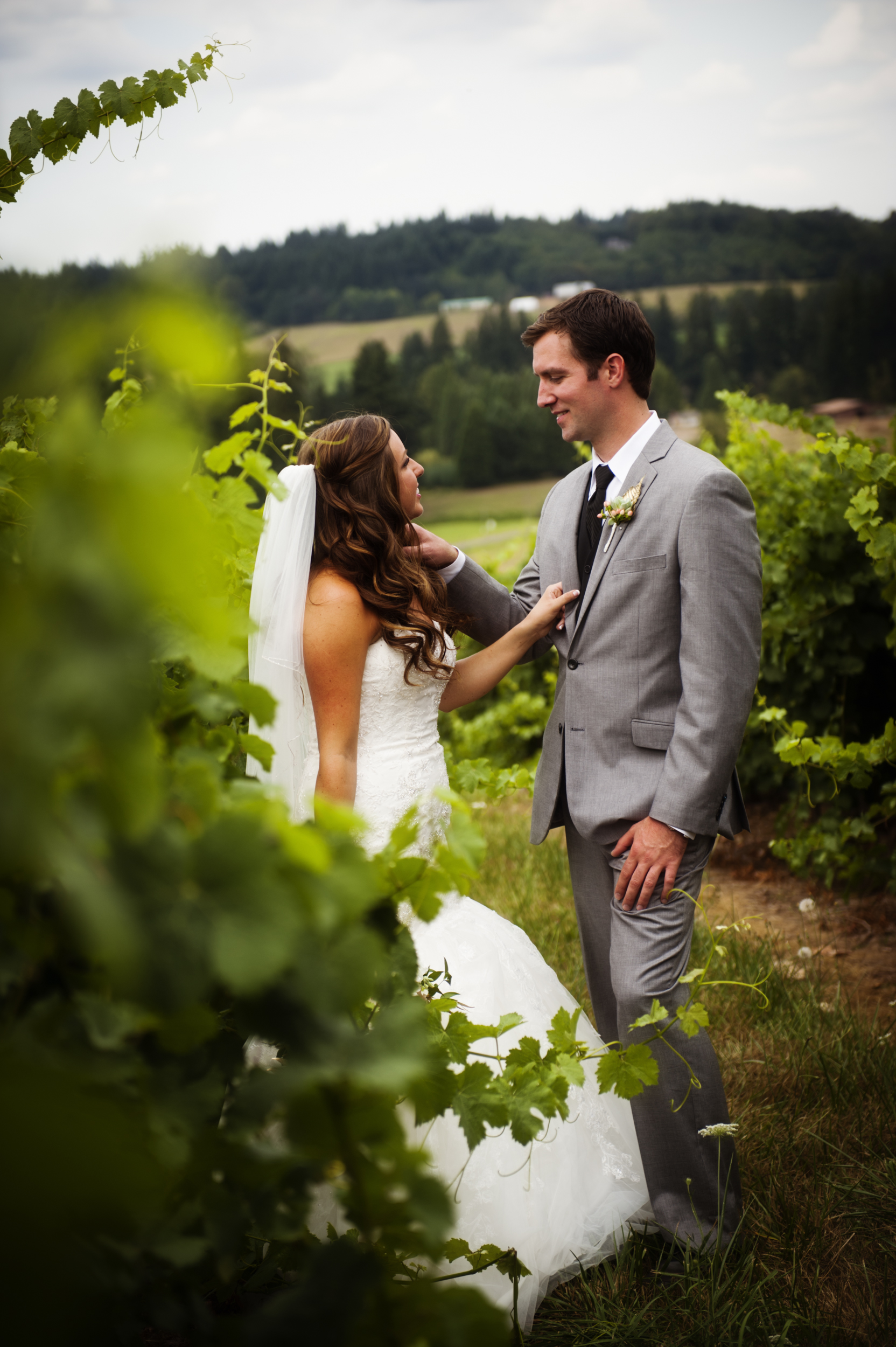 Portrait of couple on wedding day in vines at Kings Raven Vineyard in Oregon City, Oregon by Ripe Photography.