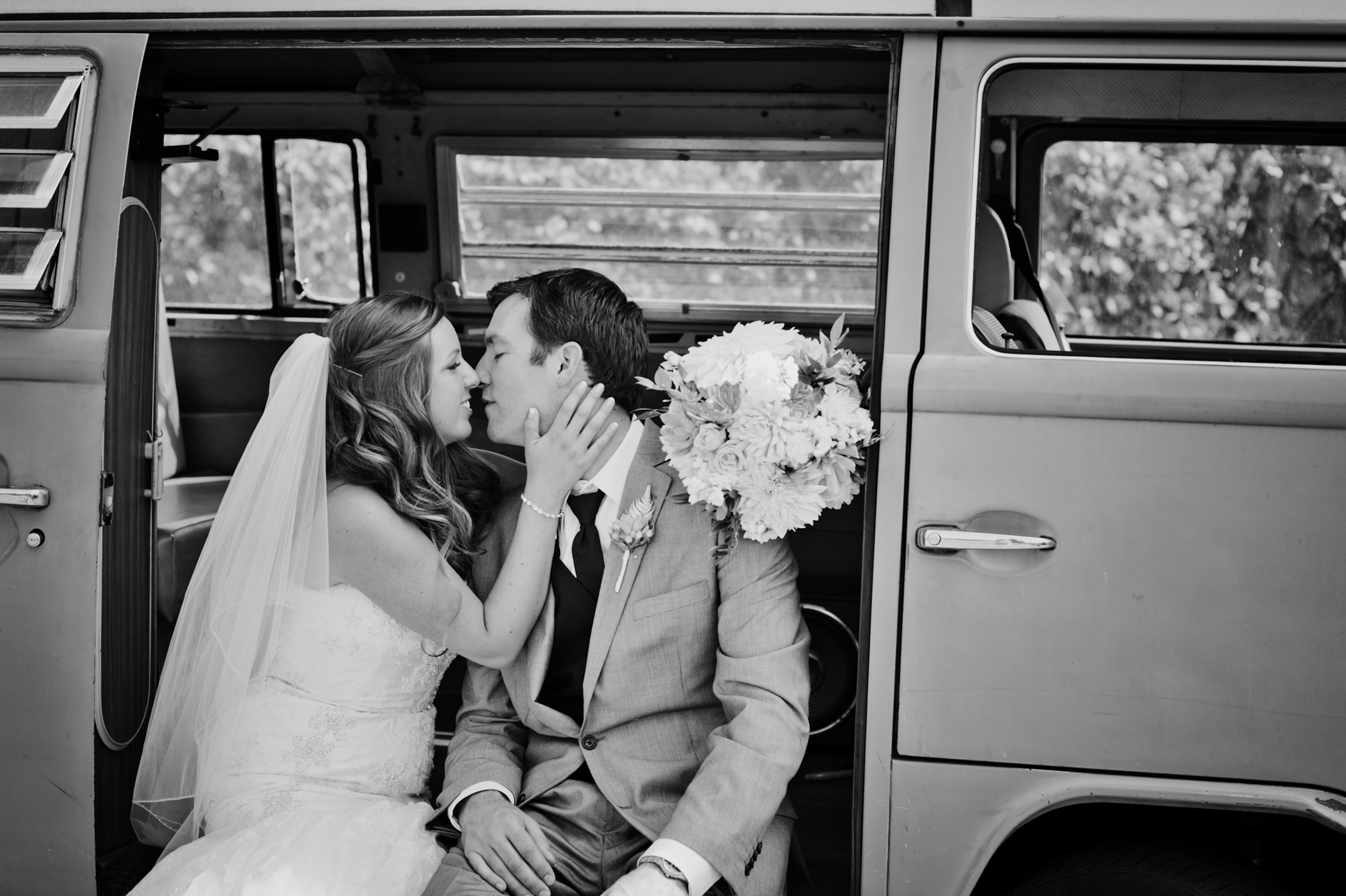 Portrait of couple in Volkswagon Bus on wedding day by Ripe Photography.