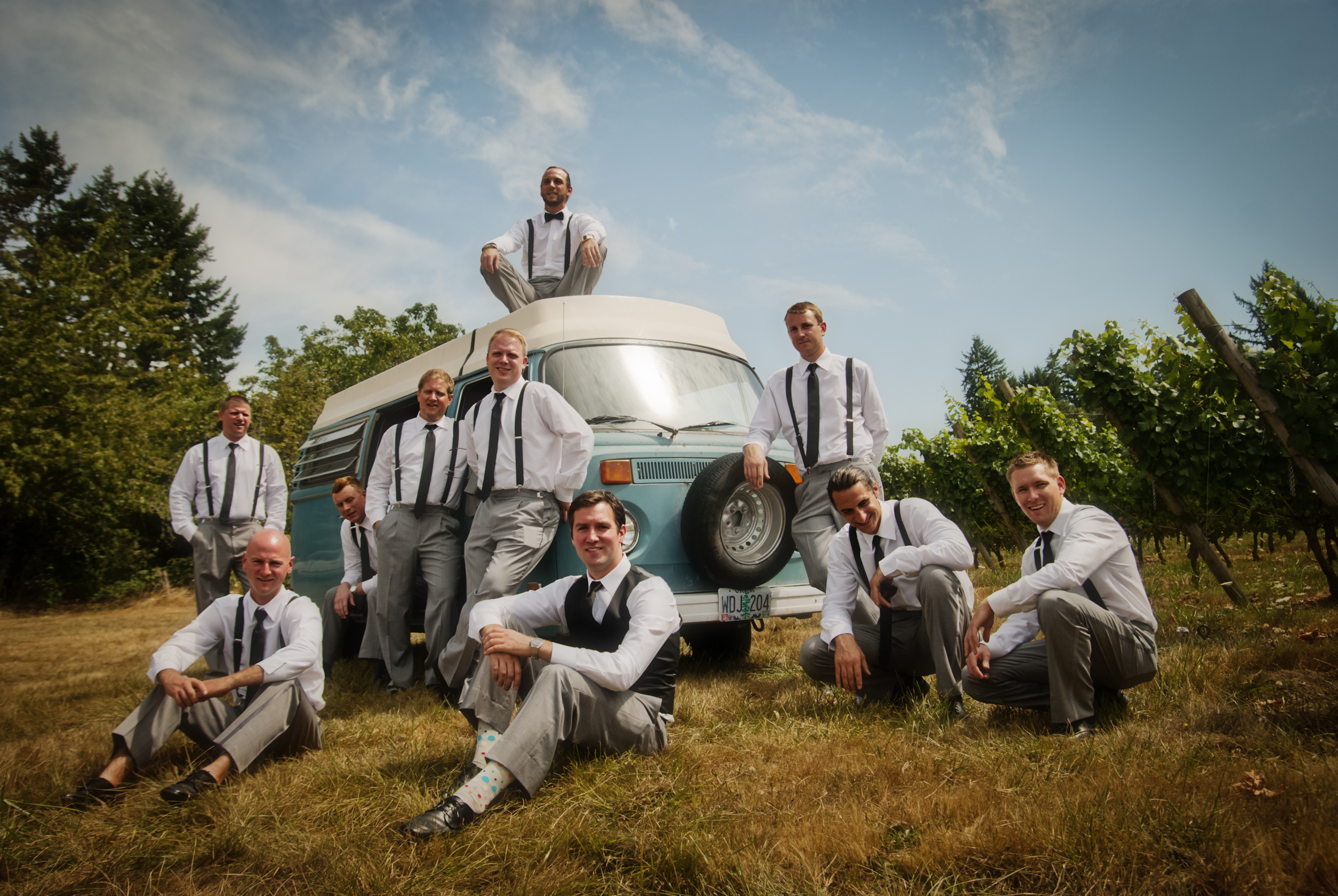 Portrait of groom and groomsmen on Volkswagon bus  at Kings Raven Vineyard by Ripe Photography.