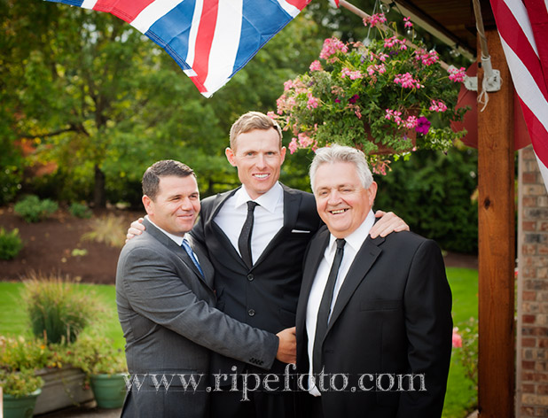 Portrait of groom with family by Ripe Photography.