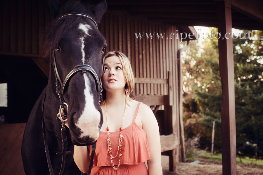 Portrait of teen and horse near barn by Ripe Photography.