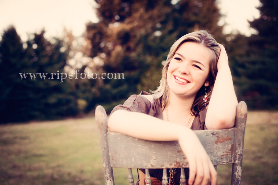 Portrait of teen girl on vintage chair in field by Ripe Photography.