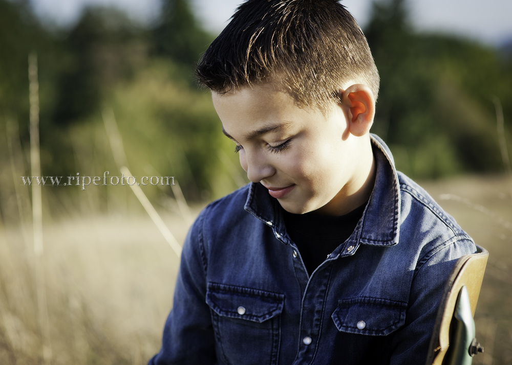 Portrait of boy in field by Portland portrait photographer Ripe Photography.