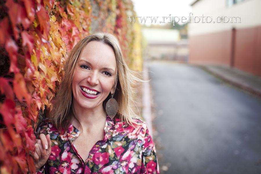 Portrait of woman near colorful vines by Portland portrait photographer Ripe Photography.