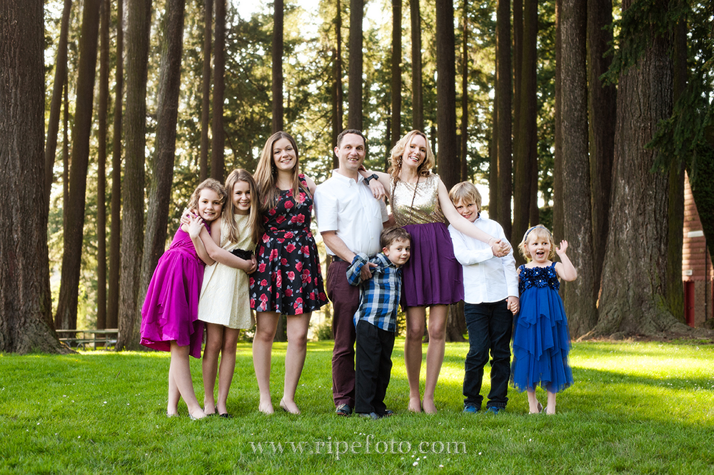 Portrait of family at with forest background at Sellwood Park in Portland, Oregon by RIpe Photography.
