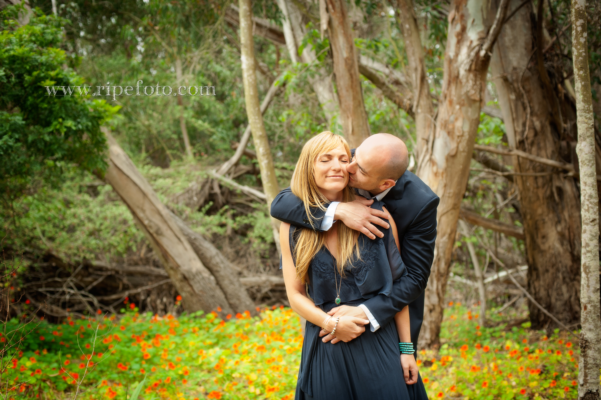 Portrait of couple in wooded background in Santa Barbara by engagement photographers at Ripe Photography.